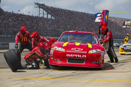 BROOKLYN, MI - JUN 17, 2012:  Jamie McMurray (1) brings in his McDonalds Chevrolet for service during the Quicken Loans 400 at the Michigan International Speedway in Brooklyn, MI.   Editoriali