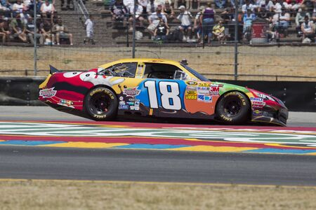 kyle: SONOMA, CA - JUN 24, 2012:  Kyle Busch (18) brings his car through the turns during the Toyota Save Mart 350 at the Raceway at Sonoma in Sonoma, CA.