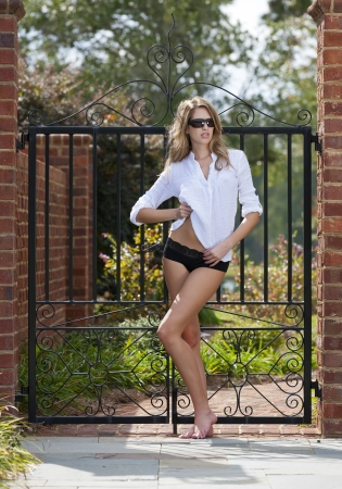 Blonde model posing in an outdoor environment photo