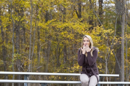 Beautiful woman cheering on her team in an outdoor environment Stock Photo - 14383152
