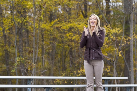 Beautiful woman cheering on her team in an outdoor environment photo