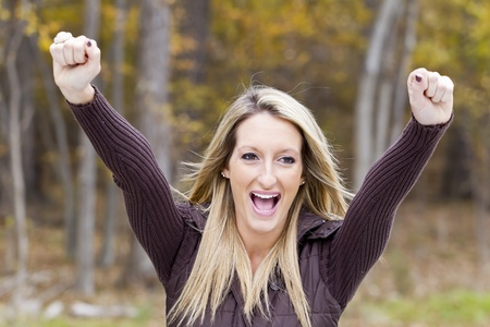 Beautiful woman cheering on her team in an outdoor environment Stock Photo - 14383150