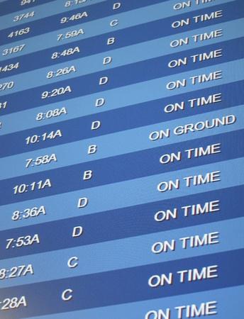 到着と出発のリスト、空港で時間板 報道画像