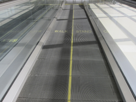 A moving walkway at a modern airport photo