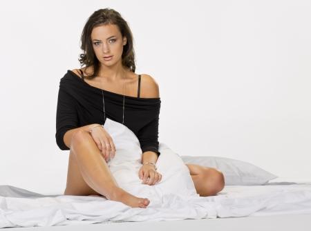 Brunette model posing in lingerie in a studio environment Stock Photo - 14706022