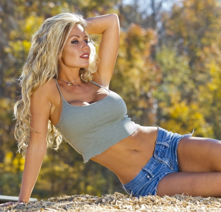 A blonde model posing outdoors at a park photo