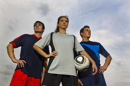 Image of male and female soccer players before a soccer game photo