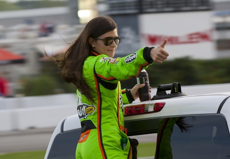 ATLANTA, GA - SEP 02, 2012   Danica Patrick  10  waves to the crowd before she races at the AdvoCare 500 at the Atlanta Motor Speedway in Hampton, GA    Éditoriale