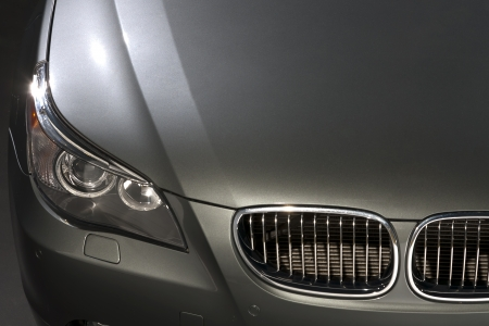 front bumper: Silver luxury car in a studio environment