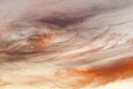 Clouds roll in at sunset in the desert sky