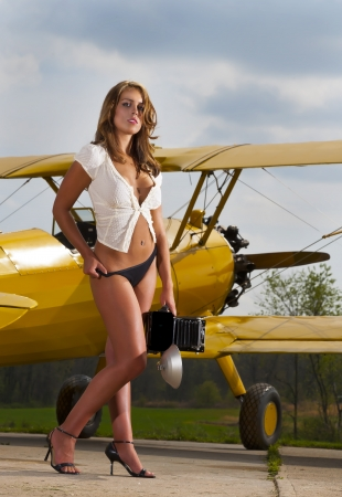 old people: Brunette model posing with a WW1 aircraft