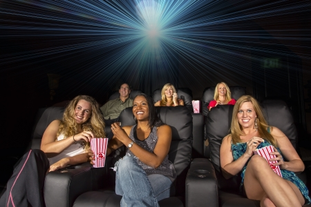 funny movies: A group of people watching a movie showing emotion