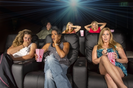 A group of people watching a movie showing emotion photo