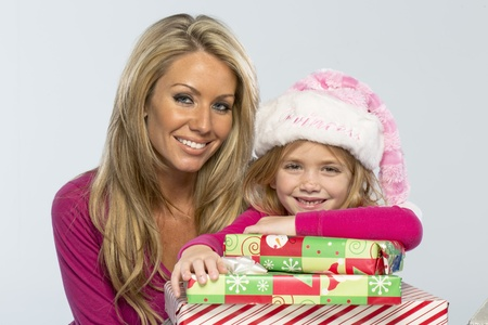 Mom and daughter with missing teeth shows excitement with presents photo