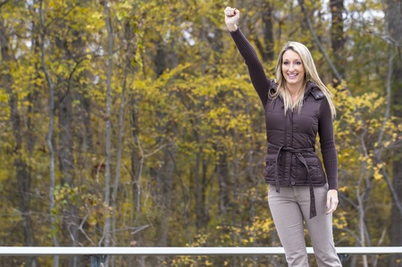 Beautiful woman cheering on her team in an outdoor environment Stock Photo - 17054431