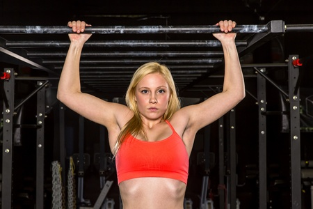 Young athlete trains with crossfit equipment photo