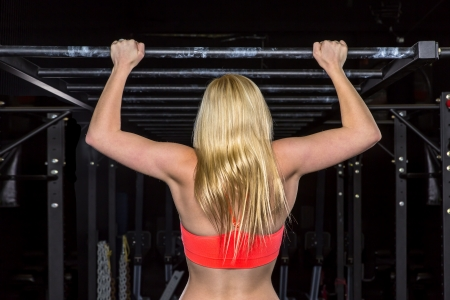 pullups: Young athlete trains with crossfit equipment Stock Photo