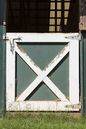 Closeup of a latch on a barn door photo