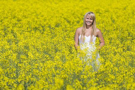 A blonde model in a field of flowers photo