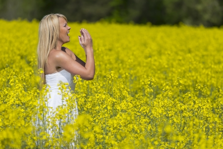 A blonde model in a field of flowers with allergies photo