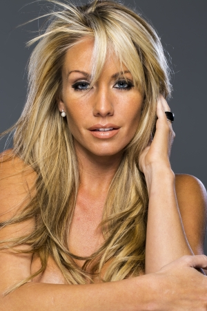 A beautiful blonde model posing in a studio environment photo