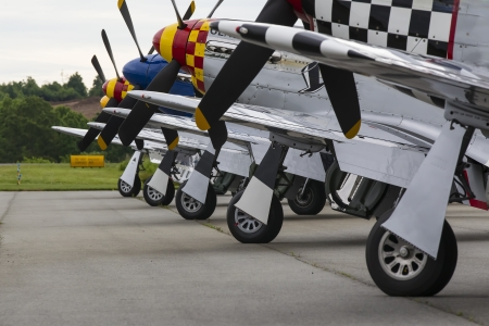 P-51 Mustang airplanes sit on the tarmac before a formation flight