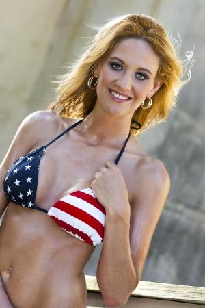 A bikini model posing in an outdoor environment  photo