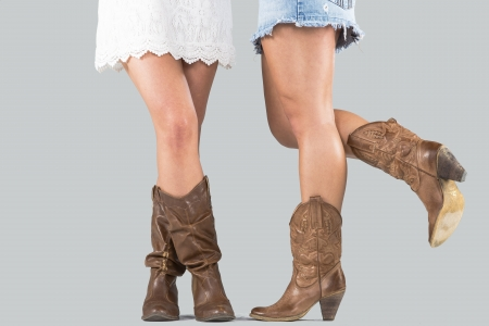Closeup view of two sets of female boots in a studio environment Stock Photo