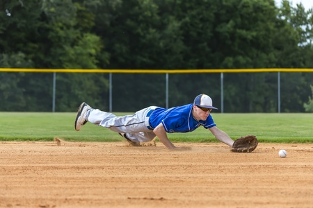 outfield: A young male plays baseball on a summer day