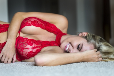 blonde: Blonde model posing in lingerie with natural lighting Stock Photo