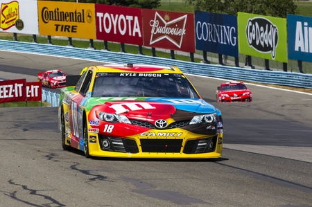 Watkins Glen, NY - Aug 11, 2013:  Kyle Busch (18) wins the Cheez-It 355 at The Glen race at the Watkins Glen International in Watkins Glen, NY. Editoriali