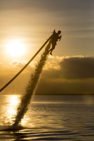 jet skier: Cancun, Mexico - Oct 16, 2013:  A unidentified man using a water powered jetpack in Cancun, Mexico on Oct 16, 2013.