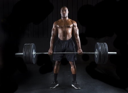 Strong sexy man deadlifts a lot of weight photo
