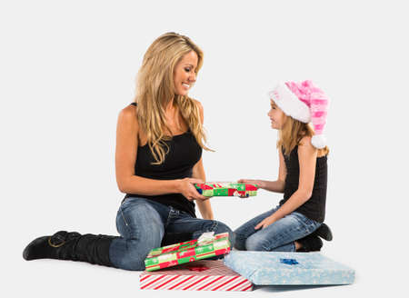 A mother and daughter pose in a studio environment with presents Stock Photo - 24060762