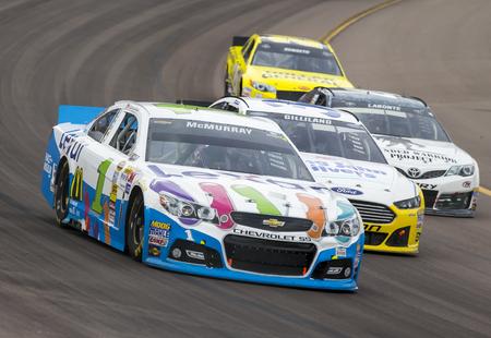 Avondale, AZ - Nov 10, 2013:  Jamie McMurray (1) brings his race car through the turns during the AdvoCare 500 race at the Phoenix International Raceway in Avondale, AZ.