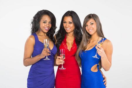 Three beautiful women celebrating an event photo