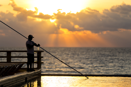 A young man cleans an endless pool at dawn photo
