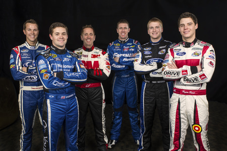 Daytona Beach, NC - Feb 19, 2014:  The Roush Fenway stable of drivers (left to right Trevor Bayne, Ricky Stenhouse, Jr., Greg Biffle, Carl Edwards, Chris Boucher, Ryan Reed) pose for their preseason shoot at the Daytona International Speedway in Daytona B Editorial