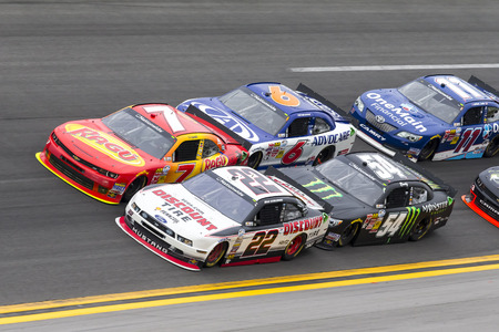 Daytona Beach, FL - Feb 22, 2014:  Regan Smith (7) holds off Brad Keselowski (22), Trevor Bayne (6), Kyle Busch (54) and the rest of the field to win the DRIVE4COPD 300 at Daytona International Speedway in Daytona Beach, FL. Editorial