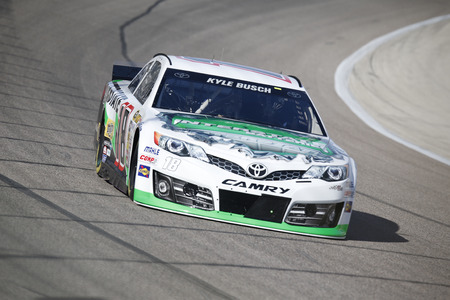 kyle: Fort Worth, TX - Apr 04, 2014:  Kyle Busch (18) brings his race car through the turns during a practice session for the Duck Commander 500 at Texas Motor Speedway in Fort Worth, TX. Editorial