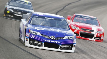 Fort Worth, TX - Apr 04, 2014:  Denny Hamlin (11) takes to the track for a practice session for the Duck Commander 500 at Texas Motor Speedway in Fort Worth, TX. Editorial