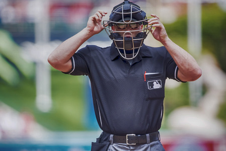 Anaheim, CA - Apr 13, 2014: Home plate umpire, Toby Basner, calls the plays against the LA Angels at Angels Stadium at Anaheim in Anaheim, CA.  The Angels went on to win the game, 14-2.   Editorial