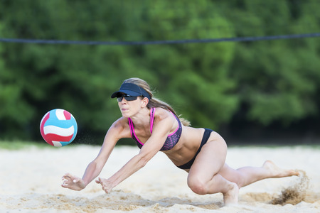A female beach volleyball athlete on the volleyball court Stock Photo