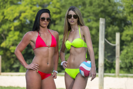 Two female athletes playing beach volleyball Banco de Imagens