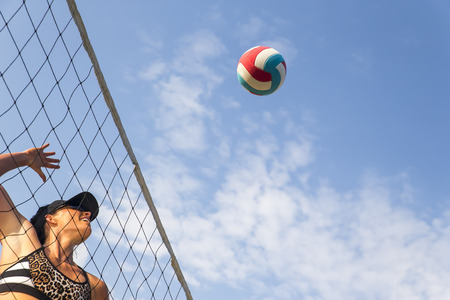 Two female athletes playing beach volleyball Stock Photo