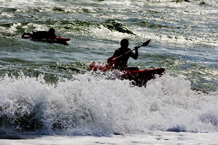 lifesaving: Lifeguards practice their lifesaving skills in the ocean