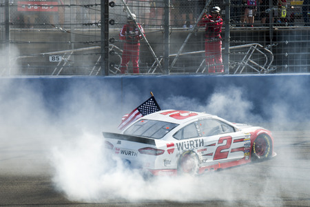 fontana: Fontana, CA - Mar 22, 2015:  Brad Keselowski (2) does his burnout after winning the Auto Club 400 at Auto Club Speedway in Fontana, CA. Editorial