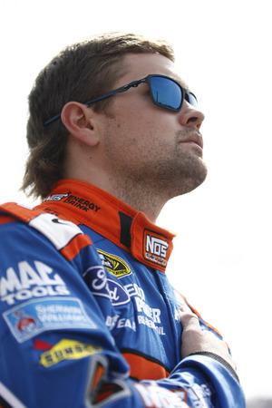fontana: Fontana, CA - Mar 22, 2015:  Ricky Stenhouse Jr. (17) stands during the National Anthem before the Auto Club 400 at Auto Club Speedway in Fontana, CA. Editorial