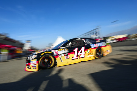 fontana: Fontana, CA - Mar 21, 2015:  Tony Stewart (14) takes to the track to practice for the Auto Club 400 at Auto Club Speedway in Fontana, CA. Editorial