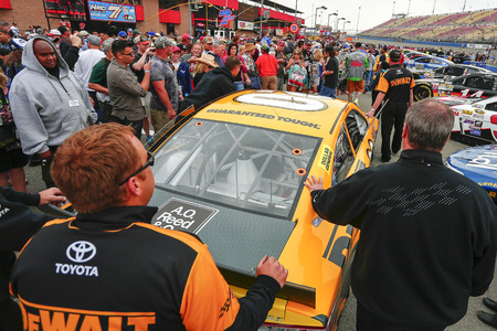 Fontana, CA - Mar 22, 2015:  The DeWalt crew push their Toyota Camry to the grid before the start of the Auto Club 400 at Auto Club Speedway in Fontana, CA.